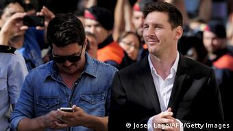 Barcelona football star Lionel Messi (R) and his brother Rodrigo arrive to the courhouse in the coastal town of Gava near Barcelona on September 27, 2013 to face judges on tax evasion charges. Messi and his father are accused of trying to deceive the Spanish taxman to the tune of four million euros ($5 million, £3.4 million) by ceding the player's image rights to companies based in tax havens such as Belize and Uruguay. AFP PHOTO / JOSEP LAGO (Photo credit should read JOSEP LAGO/AFP/Getty Images)