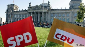 SPD and CDU banners outside of Germany's parliament Photo: Gero Breloer dpa