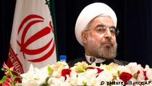 Iranian President Hassan Rouhani takes his chair before a news conference at the Millennium Hotel in midtown Manhattan, Friday, Sept. 27, 2013, in New York. (AP Photo/John Minchillo