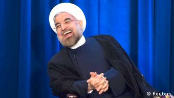 Iran's President Hassan Rohani laughs as he speaks during an event hosted by the Council on Foreign Relations and the Asia Society in New York, September 26, 2013. REUTERS/Keith Bedford (UNITED STATES - Tags: POLITICS) FREI FÜR SOCIAL MEDIA