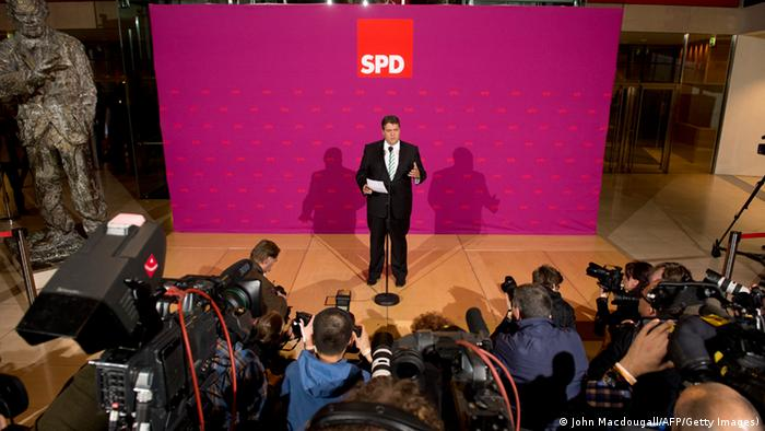 GettyImages 182027849 Chairman of the Social Democratic Party Sigmar Gabriel addresses reporters after an extraordinary party convention at the SPD headquarters in Berlin on September 27, 2013, ahead of coalition talks with German Chancellor's Christian Democratic Union. AFP PHOTO / JOHN MACDOUGALL (Photo credit should read JOHN MACDOUGALL/AFP/Getty Images)