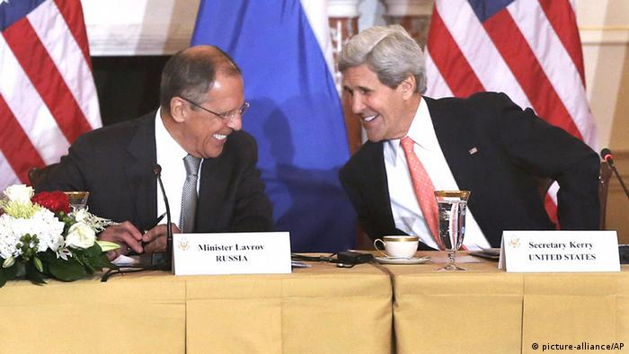 Secretary of State John Kerry smiles and talks with Russian Foreign Minister Sergei Lavrov after they made statements to reporters during their meeting at the State Department in Washington, Friday, Aug. 9, 2013. The crisis in Syria, arms control and missile defense headline what are expected to be chilly talks between top U.S. and Russian foreign and defense chiefs, a sit-down tainted by the case of National Security Agency leaker Edward Snowden, which led President Barack Obama to cancel his upcoming meeting with Russian President Vladimir Putin. (AP Photo/Charles Dharapak)