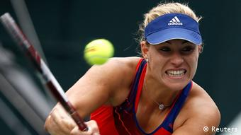 Angelique Kerber of Germany returns a shot against Petra Kvitova of the Czech Republic during their singles final match at the Pan Pacific Open tennis tournament in Tokyo September 28, 2013. REUTERS/Toru Hanai (JAPAN - Tags: SPORT TENNIS)