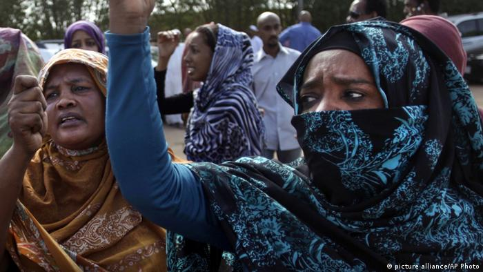 Sudanese relatives of Salah Sanhory, 26, who was killed on Friday Sept. 27, 2013 by security forces, mourn during his funeral in Khartoum, Sudan, Saturday, Sept. 28, 2013. The regime of President Omar al-Bashir is trying to stop public anger over fuel price hikes from turning into an Arab Spring-style uprising against his 24-year rule. But a crackdown by security forces appears to be fueling the unrest. (AP Photo/Khalil Hamra)