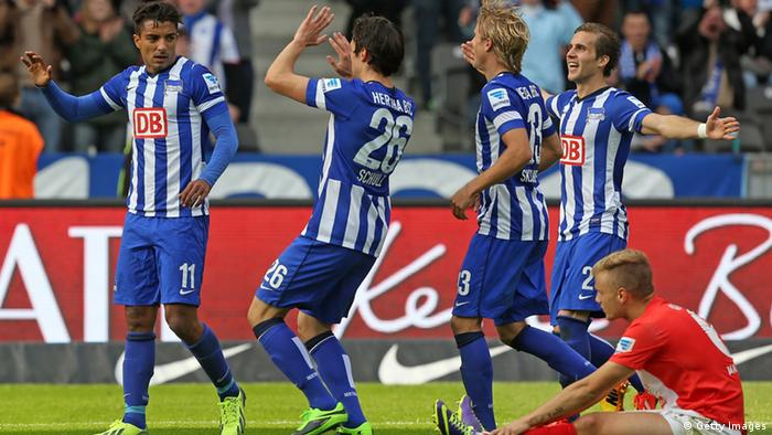 BERLIN, GERMANY - SEPTEMBER 28: Sami Allagui (L) of Berlin jubilates with team mates after scoring the third goal during the Bundesliga match between Hertha BSC and 1.FSV Mainz 05 at Olympiastadion on September 28, 2013 in Berlin, Germany. (Photo by Matthias Kern/Bongarts/Getty Images)