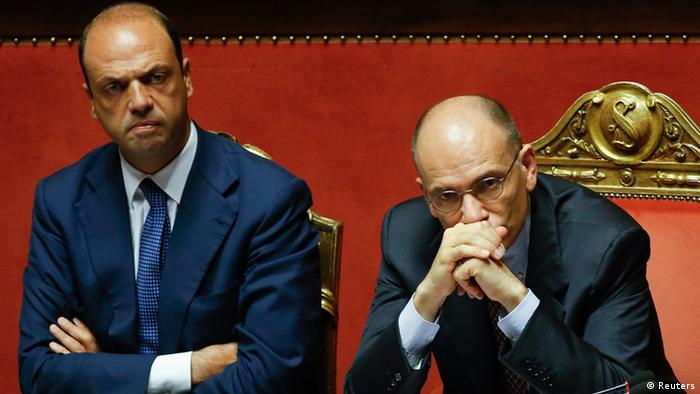 Italy's Prime Minister Enrico Letta (R) looks on next to Interior minister Angelino Alfano during a vote session at the Senate in Rome in this file photo dated July 19, 2013. Italian centre-right leader Silvio Berlusconi pulled his ministers out of the ruling coalition on Saturday, effectively bringing down the government of Prime Minister Enrico Letta and leaving Europe's third-largest economy in chaos. REUTERS/Remo Casilli/Files (ITALY - Tags: POLITICS)