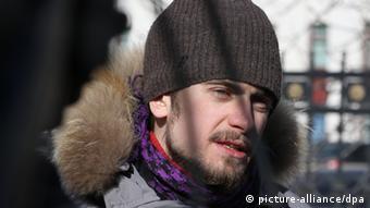 Pyotr Verzilov stands outside in Russia on a sunny winter day (Photo ITAR-TASS / Anton Novoderezhkin)
