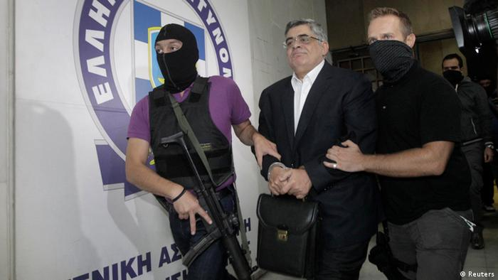 Far-right Golden Dawn party leader Nikos Mihaloliakos is escorted by anti-terrorism police officers as he leaves the Greek police headquarters in Athens September 28 (Photo: REUTERS/John Kolesidis)