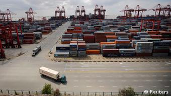 Container trucks drive past the container area at the Yangshan Deep Water Port, part of the newly announced Shanghai Free Trade Zone, south of Shanghai September 26, 2013. (Photo: Reuters)