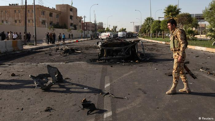 Kurdish security forces inspect the site of a bomb attack in the city of Arbil, the capital of the autonomous Kurdistan region, about 350 km (217 miles) north of Baghdad, September 29, 2013. Six people were killed on Sunday in a series of explosions outside a security directorate in the capital of Iraq's usually peaceful autonomous Kurdistan region, security and medical sources said. Gunfire could be heard after the blasts in Arbil that wounded a further 36 people, according to the city's health directorate. The victims were believed to be members of the Iraqi Kurdish security forces, known as asayesh. REUTERS/Azad Lashkari (IRAQ - Tags: POLITICS CIVIL UNREST)