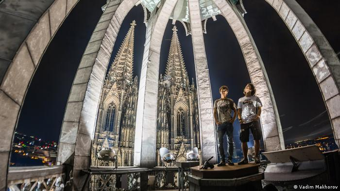 Picture of 24 year-old Vadim Makhorov and 20 year-old Vitaliy Raskalov inside the cupola of the Cologne Cathedral at night.