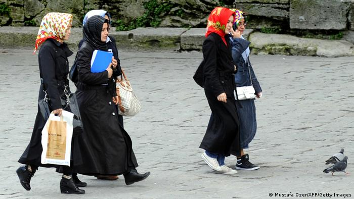 TO GO WITH AFP STORY IN FRENCH BY NICOLAS CHEVIRON Turkish women wearing a headscarves walk at the Beyazit Square near the Istanbul University on October 23, 2010. After a 12-year ban students wearing headscarves are allowed to attend classes since the begining of October. AFP PHOTO / MUSTAFA OZER (Photo credit should read MUSTAFA OZER/AFP/Getty Images)