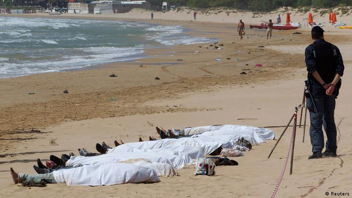 Bodies of migrants who drowned lie on the beach in the Sicilian village of Sampieri September 30, 2013. At least 13 people on a migrant boat arriving in Sicily drowned close to the coast near the eastern city of Ragusa, apparently after trying to disembark from their stranded vessel, Italian authorities said on Monday. Officials said the boat was carrying around 250 people but there was no immediate word on where they came from. REUTERS/Gianni Mania