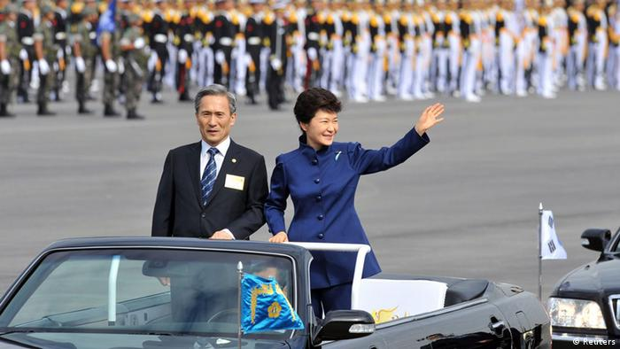 South Korean President Park Geun-Hye (R) waves as she inspects troops with Defence Minister Kim Kwan-Jin during a ceremony marking the 65th anniversary of the founding of South Korea's Armed Forces at an air base in Seongnam, south of Seoul October 1, 2013. REUTERS/Jung Yeon-je/Pool (SOUTH KOREA - Tags: POLITICS MILITARY)