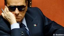 Italy's former Prime Minister Silvio Berlusconi attends a session at the Senate in Rome in this March 16, 2013 file photo. Italian centre-right leader Berlusconi pulled his ministers out of the ruling coalition on September 28, 2013, effectively bringing down the government of Prime Minister Enrico Letta and leaving Europe's third-largest economy in chaos. REUTERS/Remo Casilli/Files (ITALY - Tags: POLITICS)