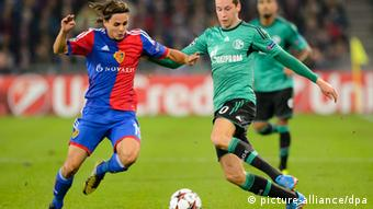 Julian Draxler, right, during an UEFA Champions League group E group stage matchday 2 soccer match between Switzerland's FC Basel 1893 and Germany's FC Schalke 04 at the St. Jakob-Park stadium in Basel, Switzerland, 01 October 2013. EPA/LAURENT GILLIERON