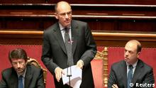 Italy's Prime Minister Enrico Letta (C), flanked by Interior Minister Angelino Alfano (R) and Democratic Party (PD) member Dario Franceschini, addresses the Senate asking for a possible call for a confidence vote immediately in Rome, October 2, 2013. Senior party figures in Silvio Berlusconi's fractious centre-right movement urged Italian lawmakers on Tuesday to defy the billionaire media tycoon and back Letta in a confidence motion expected on Wednesday. REUTERS/Tony Gentile (ITALY - Tags: POLITICS)