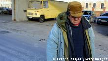 Hungarian homeless Balint wanders the streets of Budapest on January 03, 2002 as he spends the cold winter nights outside. Some 93 people, mostly homeless and elderly people, have died in 2007 due to severe cold in Hungary. Hungarian police announced on its official website that 'the raising of the people died of cold is due to the climate changes.' AFP PHOTO / FERENC ISZA (Photo credit should read FERENC ISZA/AFP/Getty Images)