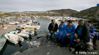 ILULISSAT, GREENLAND - AUGUST 30: (ISRAEL OUT) ) Inuit locals work in a halibut fish processing plant on August 30, 2007 in Ilulissat, Greenland. Even though the disappearing ice cap could lead to higher sea levels all over the world, Greenland's Inuit population are the first to feel the effects of global warming. Records show that the average air temperature has risen by four degrees Celsius over the past decade while the water temperature has climbed by two degrees. Fishermen and hunters avoid the fjords where the ice has become too thin to travel on, and fish such as cod, that prefer warmer water, are beginning to be seen in their nets. (Photo by Uriel Sinai/Getty Images)