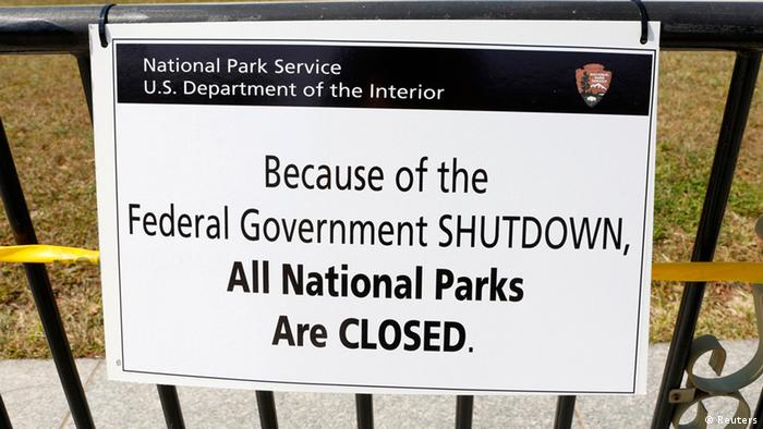 A closure sign is seen on a barricade at the World War Two Memorial in Washington October 1, 2013. Despite the U.S. government shutdown affecting the site, a barricade was removed to give veterans access to the memorial today. Up to one million federal workers were thrown temporarily out of work on Tuesday as the U.S. government partially shut down for the first time in 17 years in a standoff between President Barack Obama and congressional Republicans over healthcare reforms. REUTERS/Kevin Lamarque (UNITED STATES - Tags: POLITICS BUSINESS)