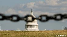 REFILE - QUALITY REPEAT The U.S. Capitol is photographed behind a chain fence in Washington September 30, 2013. As many as a million government employees were making urgent plans on Monday for a possible midnight shutdown, with their unions urging Congress to strike a last-minute deal. REUTERS/Kevin Lamarque (UNITED STATES - Tags: POLITICS BUSINESS TPX IMAGES OF THE DAY)