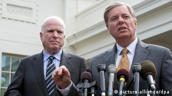United States Senators John McCain (Republican of Arizona), left, and Lindsey Graham (Republican of South Carolina), right, meet reporters at the White House in Washington, D.C. following their meeting with U.S. President Barack Obama concerning the President's initiative to gain the approval of Congress before responding the the chemical weapons attacks in Syria on Monday, September 2, 2013.