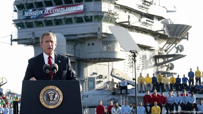 US President George W. Bush addresses the nation aboard the nuclear aircraft carrier USS Abraham Lincoln 01 May, 2003, as it sails for Naval Air Station North Island, San Diego, California. Bush declared major fighting over in Iraq, calling it 'one victory in a war on terror' which he said would continue until terrorists are defeated. 'In the Battle of Iraq, the United States and our allies have prevailed,' Bush said. Bush touted Saddam Hussein's ouster as 'a crucial advance' towards stamping out extremist violence.AFP Photo/Stephen JAFFE