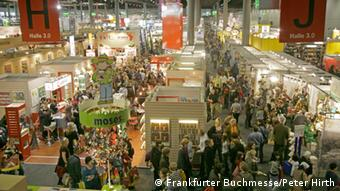 A mass of people from 2008's book fair in frankfurt, inside the building Copyright: Peter Hirth