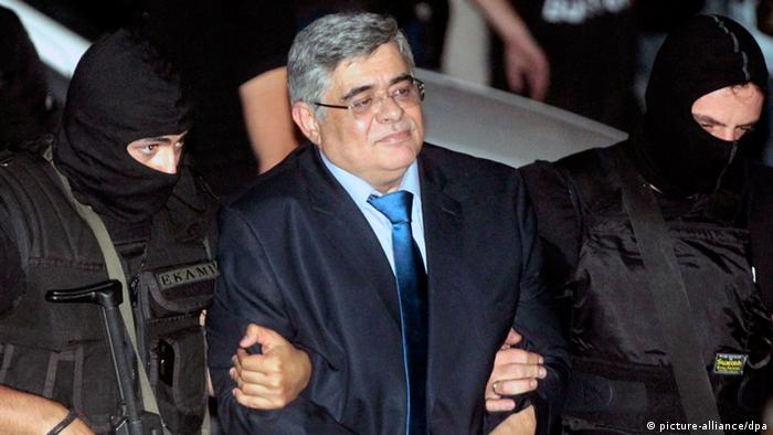 Anti-terror police officers escort Nikos Michaloliakos, leader of the ultra-right-wing Golden Dawn party at the courthouse in Athens, Greece, 02 October 2013.