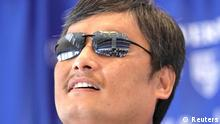 Chinese dissident Chen Guangcheng speaks at a news conference at the National Press Club in Washington October 2, 2013. Chen, the Chinese dissident and legal rights activist who accused New York University of forcing him to leave this summer because of alleged pressure from the Chinese government, will be joining The Witherspoon Institute, a conservative think tank. REUTERS/Yuri Gripas (UNITED STATES - Tags: POLITICS HEADSHOT PROFILE)