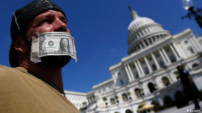 John Zangas, who identified himself as a federal employee, protests against the current government shutdown at the U.S. Capitol in Washington, October 2, 2013. REUTERS/Jonathan Ernst (UNITED STATES - Tags: POLITICS CIVIL UNREST BUSINESS EMPLOYMENT TPX IMAGES OF THE DAY)