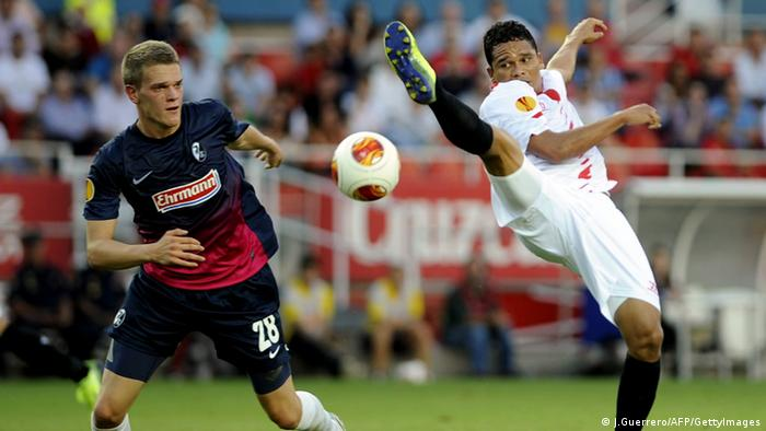 Freiburg's defender Matthias Ginter (L) vies with Sevilla's Colombian forward Carlos Bacca during the UEFA Europa league, group H, football match Sevilla FC vs SC Freiburg at the Ramon Sanchez Pizjuan stadium in Sevilla on October 3, 2013. AFP PHOTO / CRISTINA QUICLER (Photo credit should read Jorge Guerrero/AFP/Getty Images)