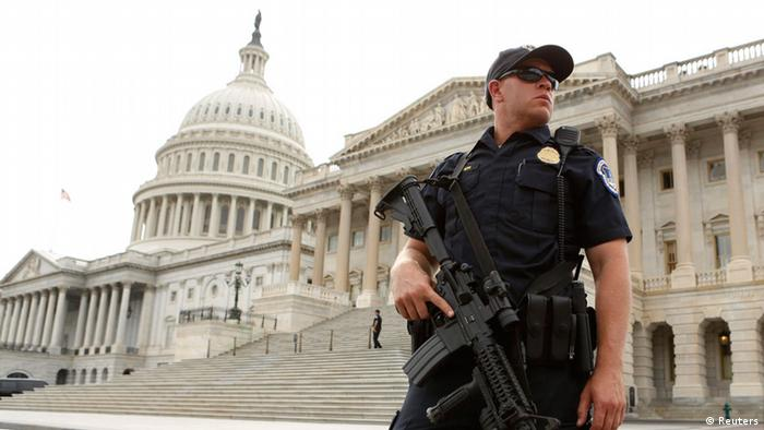 A U.S. Capitol Police officer stands guard following a shooting near the U.S. Capitol in Washington, October 3, 2013. The Capitol was in lockdown on Thursday after gunshots were fired outside the building, injuring several people including a law enforcement officer, a Senate aide and a Capitol police officer said. REUTERS/Kevin Lamarque (UNITED STATES - Tags: POLITICS CRIME LAW TPX IMAGES OF THE DAY)