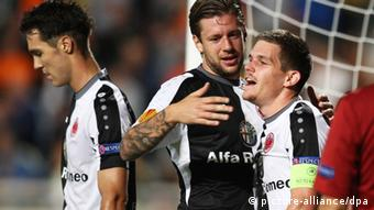 Eintracht Frankfurt players (L-R) Srdjan Lakic, Marco Russ and Sebastian Jung celebrate their 1-0 lead during the UEFA Europa League Group F soccer match between APOEL Nicosia and Eintracht Frankfurt in Nicosia, Cyprus, 03 October 2013. (Photo via EPA/STRINGER)