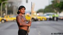An indigenous Indian holds arrows and a bow during a demonstration by indigenous Indians against proposed constitutional amendment PEC 215, which amends the rules for demarcation of indigenous lands, in Brasilia October 3, 2013. According to the organizers, the protest is part of the National Indigenous Mobilization, with events in various parts of Brazil from September 30 to October 5, to defend the territorial rights of the indigenous population against the government, agribusiness and large mining and energy companies. REUTERS/Ueslei Marcelino (BRAZIL - Tags: POLITICS SOCIETY ENVIRONMENT CIVIL UNREST)
