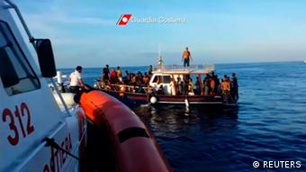 Boatpeople off Lampedusa (photo: REUTERS/Italian Coast Guard)