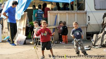 Roma children stand in their camp on October 1, 2013 in Roubaix, northern France. (Photo: PHILIPPE HUGUEN/AFP/Getty Images)