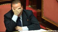 ARCHIV - Former Italian Prime Minister Silvio Berlusconi of the People of Freedom (PDL) party reacts at the Italian Senate, Rome, Italy, 02 October 2013. EPA/ALESSANDRO DI MEO (zu dpa Senatsausschuss entscheidet über Rauswurf Berlusconis vom 04.10.2013) +++(c) dpa - Bildfunk+++