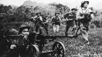 Viet Cong soldiers moving forward under covering fire from a heavy machine gun during the Vietnam War, circa 1968. (Photo by Three Lions/Hulton Archive/Getty Images)