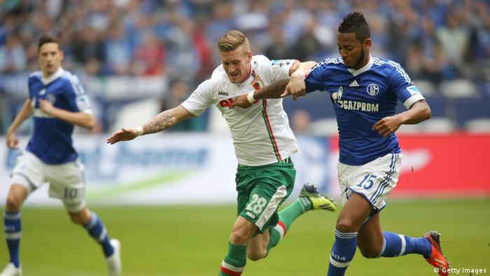 Dennis Aogo of Schalke (R( and Andre Hahn of Augsburg fight for the ball