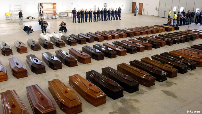 Coffins of victims from a shipwreck off Sicily are seen in a hangar of the Lampedusa airport October 5, 2013. Rough seas again blocked efforts to recover the bodies trapped inside a boat that sank on Thursday, killing an estimated 300 Eritrean and Somali men, women and children who were seeking a better life in Europe. REUTERS/Antonio Parrinello (ITALY - Tags: DISASTER)