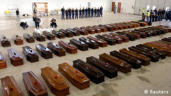Coffins of victims from a shipwreck off Sicily are seen in a hangar of the Lampedusa airport October 5, 2013. (Photo: REUTERS/Antonio Parrinello)