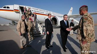 German Defence Minister Thomas de Maiziere (C) and Foreign Minister Guido Westerwelle (L) are welcomed by German Bundeswehr armed forces General Joerg Vollmer (R) upon their arrival in Camp Mamal in the northern city of Mazar-e-Sharif October 6, 2013. REUTERS/Fabrizio Bensch (AFGHANISTAN - Tags: MILITARY POLITICS)
