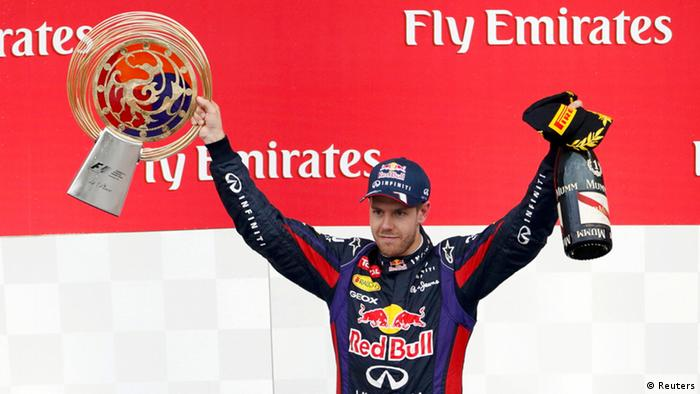 Red Bull Formula One driver Sebastian Vettel of Germany celebrates winning the Korean F1 Grand Prix at the Korea International Circuit in Yeongam, October 6, 2013. REUTERS/Lee Jae-Won (SOUTH KOREA - Tags: SPORT MOTORSPORT F1 TPX IMAGES OF THE DAY)