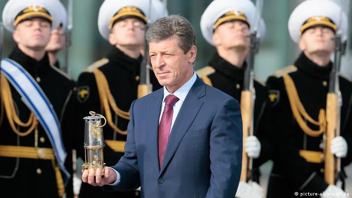 Deputy Prime Minister Dmitry Kozak carries the Olympic flame for the upcoming 2014 Winter Games during a welcome ceremony at Moscow's Vnukovo Airport (Photo ITAR-TASS / Mikhail Metzel)