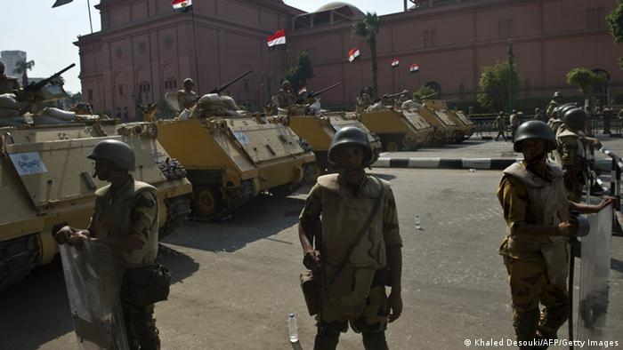 Egyptian army's soldiers stand guard in front of the Egyptian museum on Tahrir Square during a gathering marking the 40th anniversary of the 1973 Arab-Israeli war on October 6, 2013 in the capital Cairo. Egypt braced for rival demonstrations called by supporters and opponents of deposed Islamist president Mohamed Morsi during the anniversary's festivities. AFP PHOTO / KHALED DESOUKI (Photo credit should read KHALED DESOUKI/AFP/Getty Images)