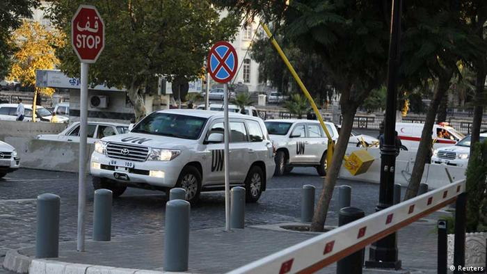UN vehicles transporting OPCW team (Photo: REUTERS/Khaled al-Hariri)