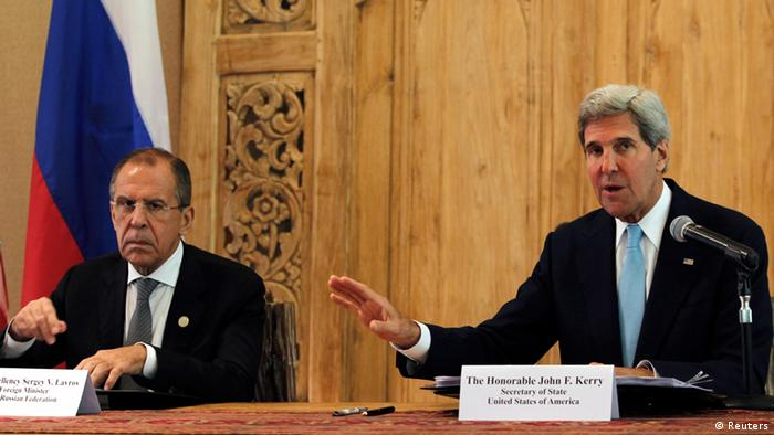 U.S. Secretary of State John Kerry (R) gestures during a joint news conference with Russia's Foreign Minister Sergey Lavrov at their bilateral meeting on the sidelines of Asia-Pacific Economic Cooperation (APEC) Summit in Nusa Dua on the Indonesian resort island of Bali October 7, 2013. REUTERS/Beawiharta (INDONESIA - Tags: POLITICS)