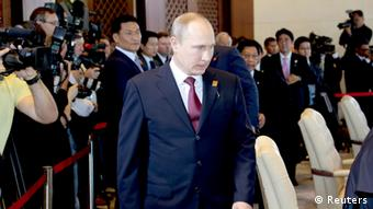 Russia's President Vladimir Putin arrives at the Leaders Retreat during the Asia-Pacific Economic Cooperation (APEC) Summit in Nusa Dua on the Indonesian resort island of Bali, October 7, 2013. REUTERS/Dita Alangkara/Pool (INDONESIA - Tags: POLITICS)