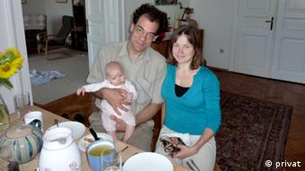Man, woman, baby Emans family